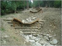 Fig.22 - Barrage comprenant une cuvette avec parement en pierres à la Norma (Savoie - France).