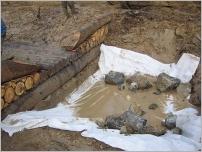 Fig.36 - Création d'une fosse de dissipation de l'énergie hydraulique en pied d'un caisson bois.