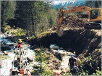 Fig.46 - Construction du support du caisson en enrochement.